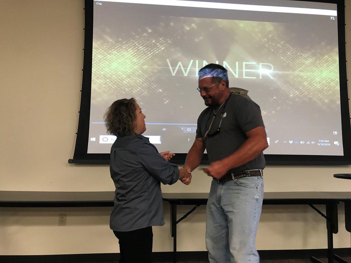 Lana Brown Human Resources Manager at Michael Hatcher & Associates presenting award