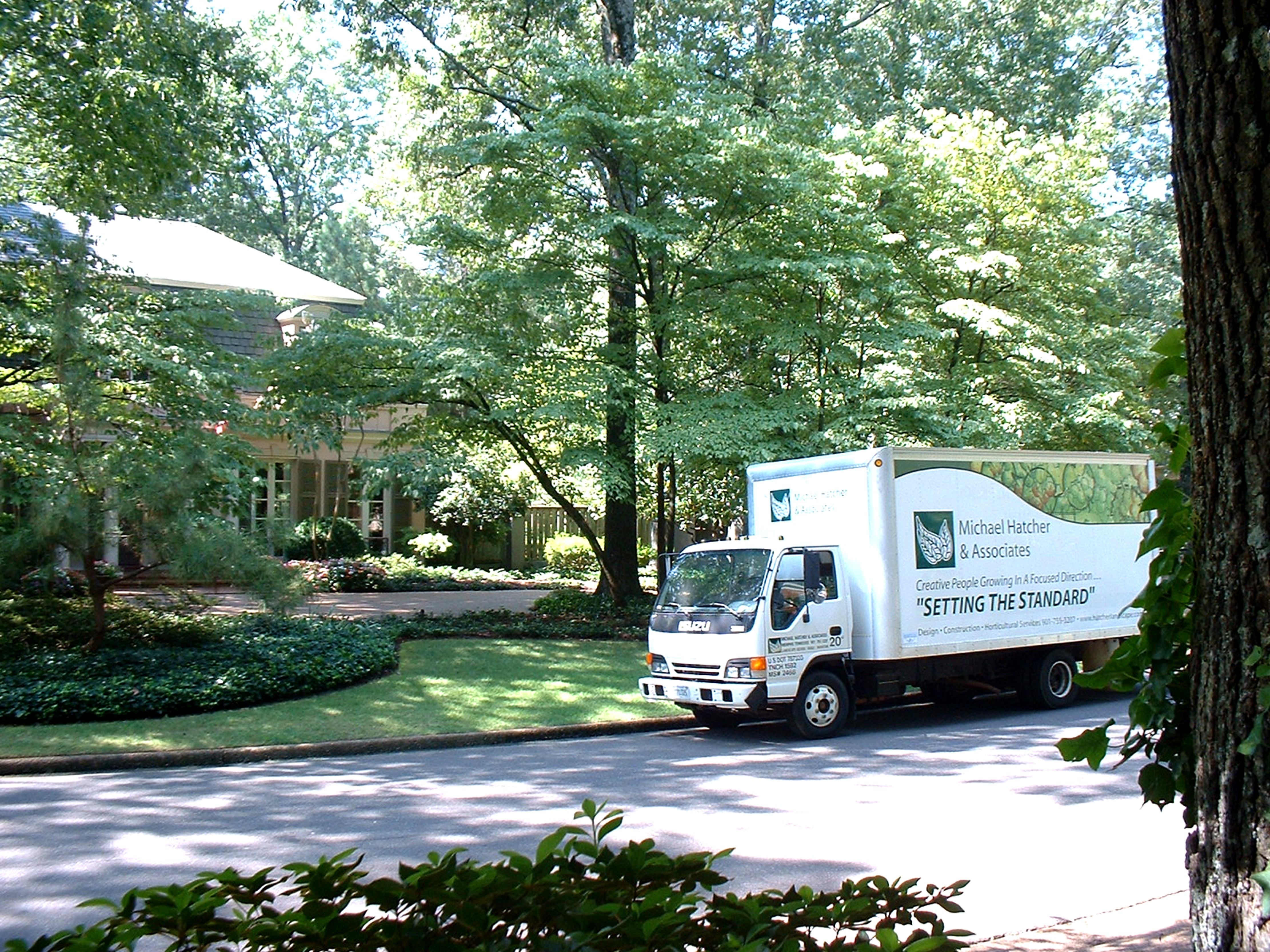 Michael Hatcher team providing lawn care services to a client in Memphis, TN