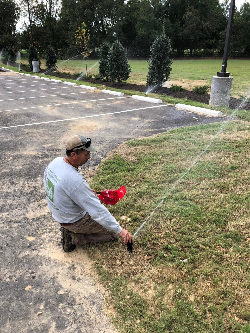 Tommy Neergaard adjusting an irrigation head
