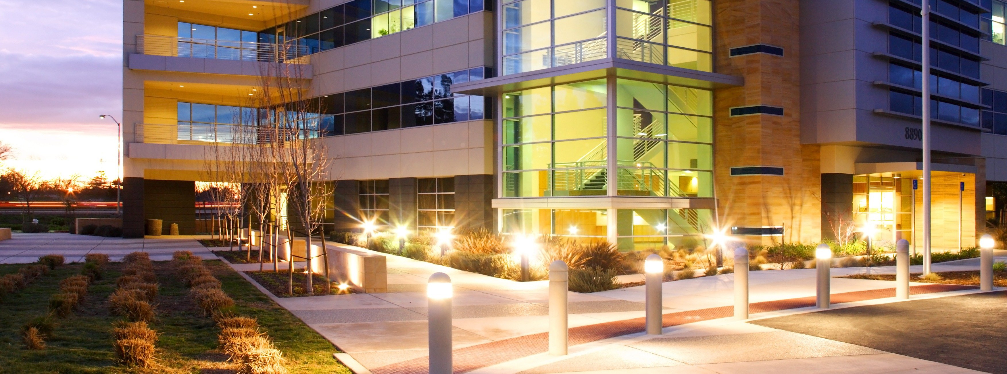 building with commercial landscape lighting