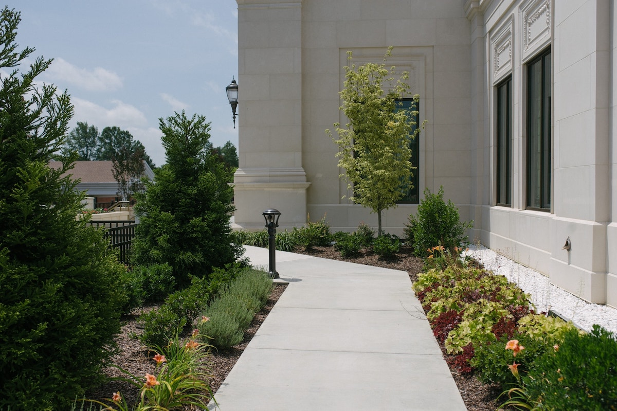 plant beds with mulch along walkway
