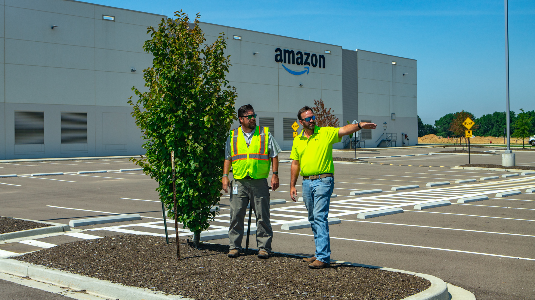 Commercial landscaping Account Manager and Company Manager inspecting the Amazon fulfillment property with the client