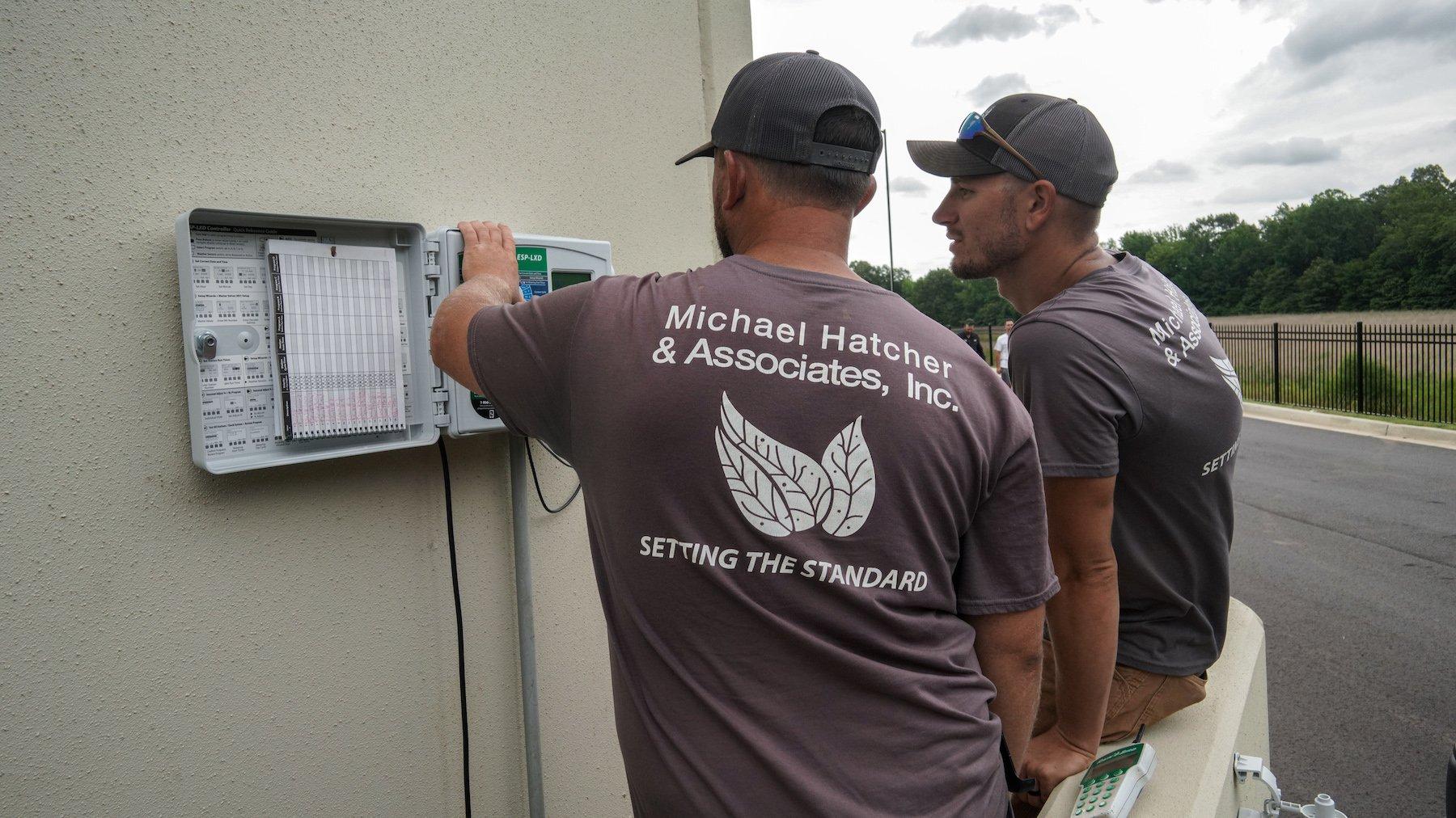 Commercial Irrigation team making adjustments to sprinkler system