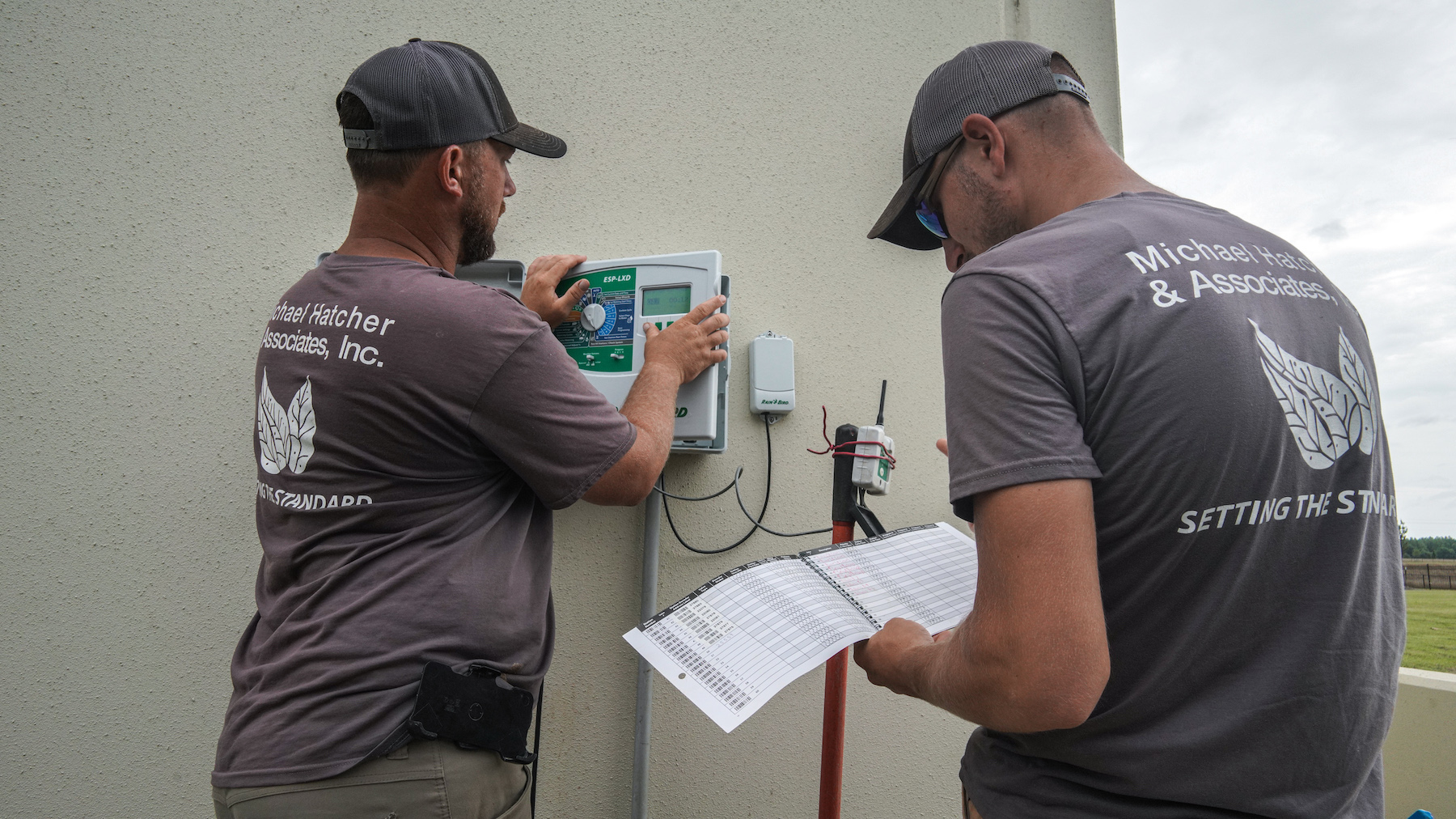 Crew performing monthly irrigation system inspection