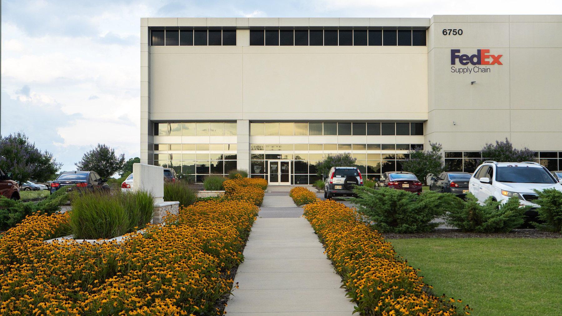FedEx Warehouse with perennial plantings along sidewalk
