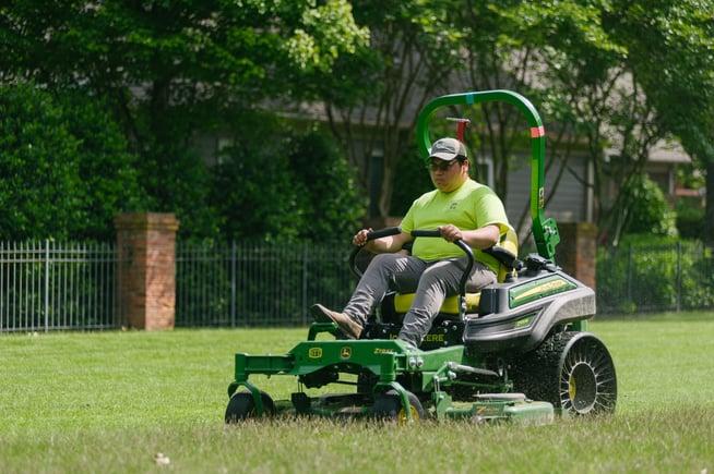Technician mowing commercial landscape