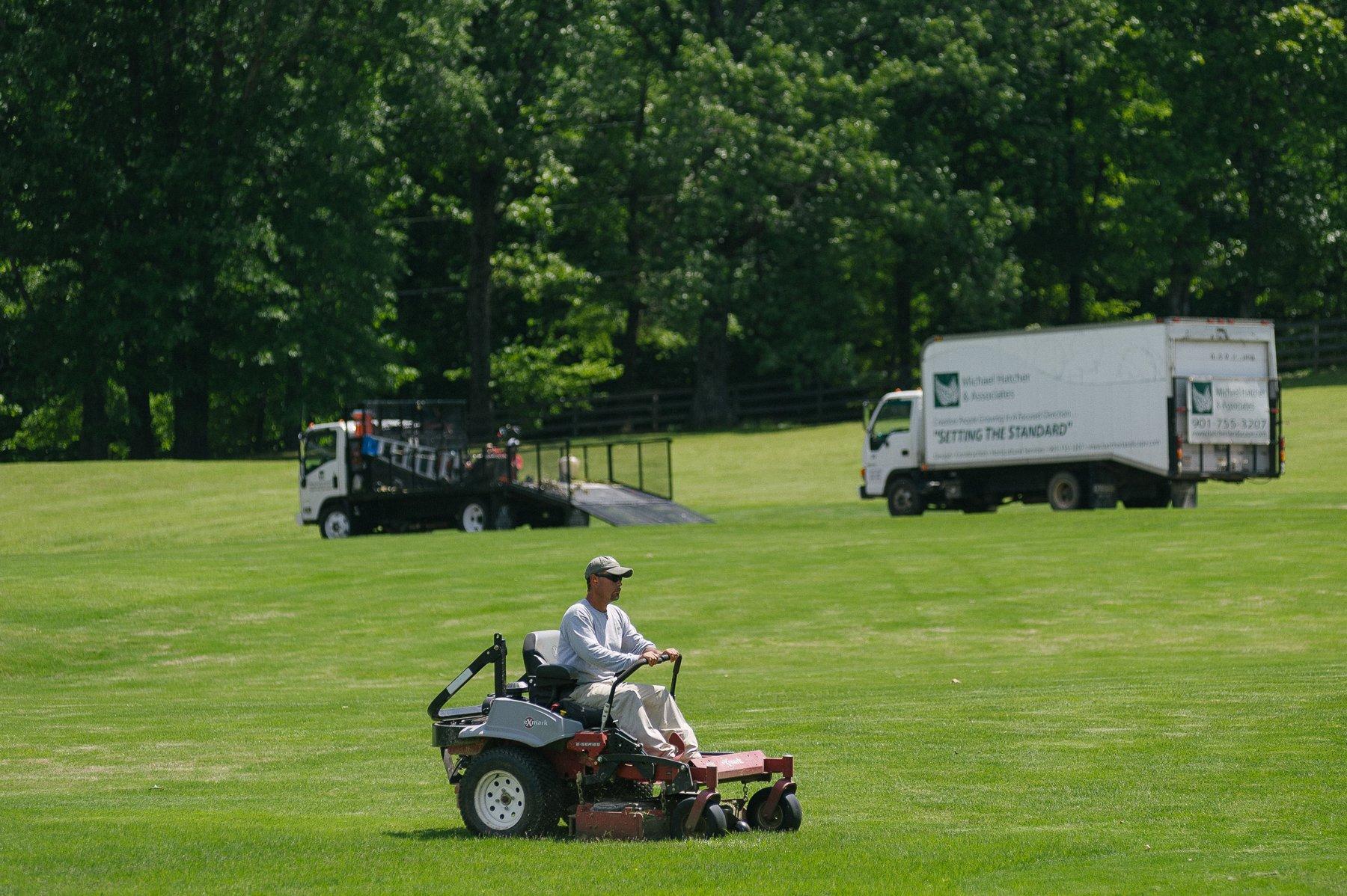Michael Hatcher & Associates landscape maintenance crew mowing property