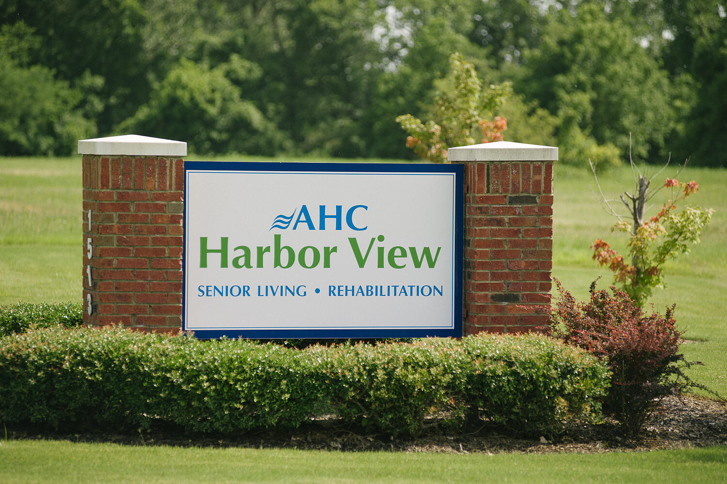 AHC Harbor View Senior Living Sign with clear view plantings