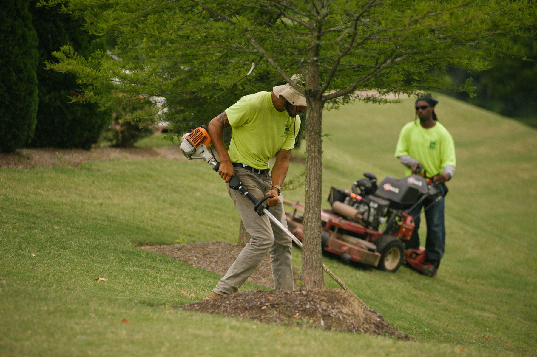 Commercial landscape mowing and maintenance team