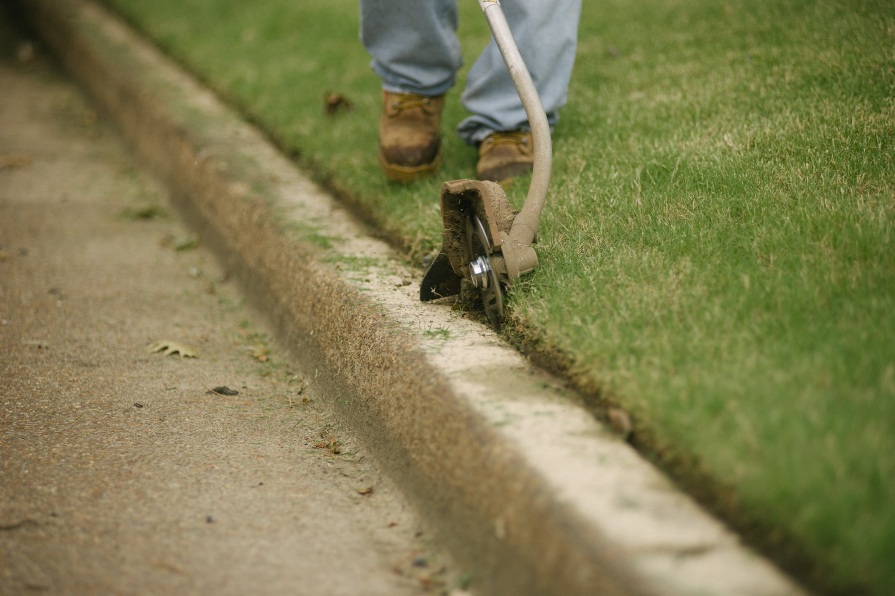 Commercial lawn care team edging