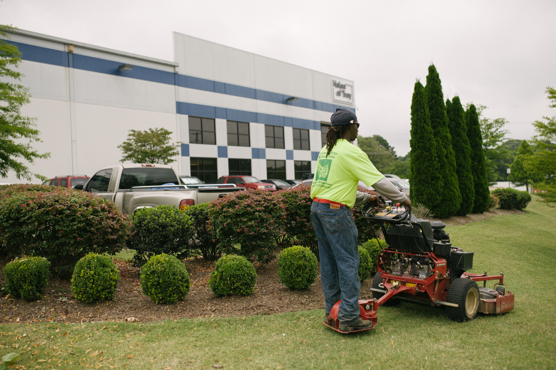 Commercial lawn care team mowing