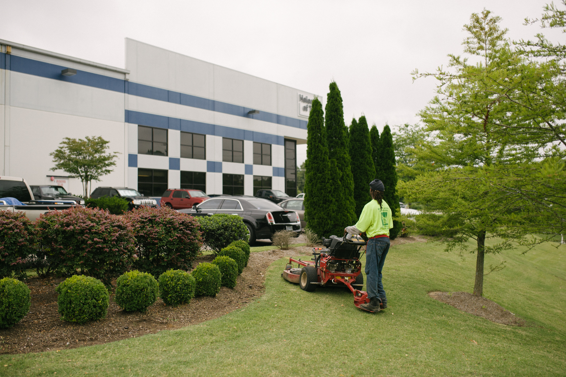 technician mowing commercial property