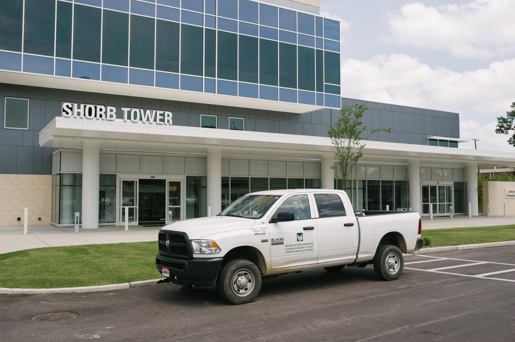 Michael Hatcher landscaping truck at commercial property