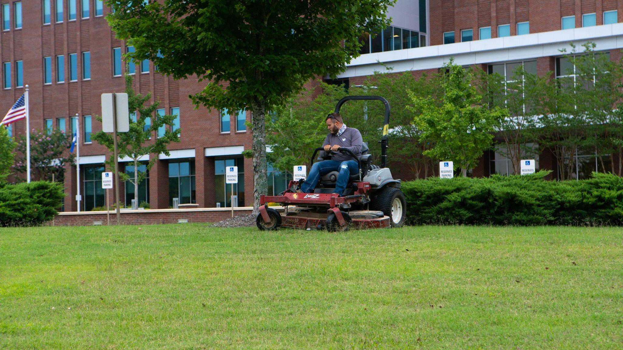 Michael Hatcher & Associates mowing Methodist Olive Branch Hospital landscape