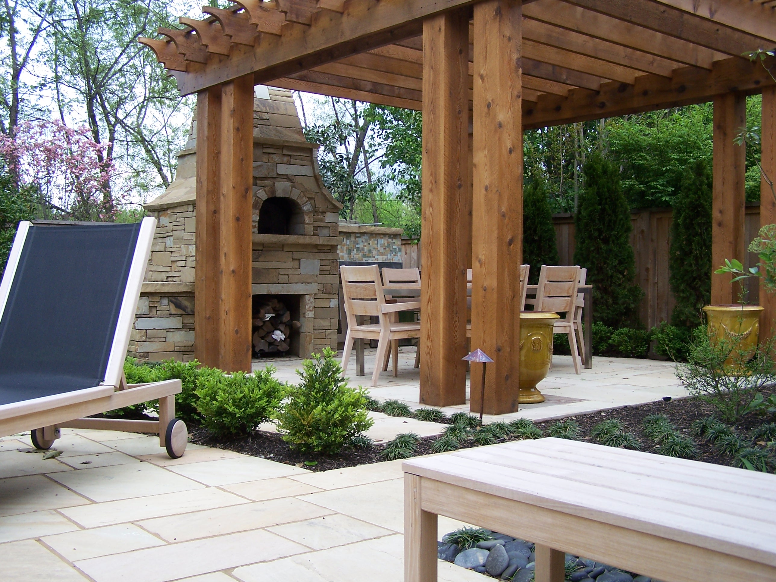 outdoor fireplace and pergola with table