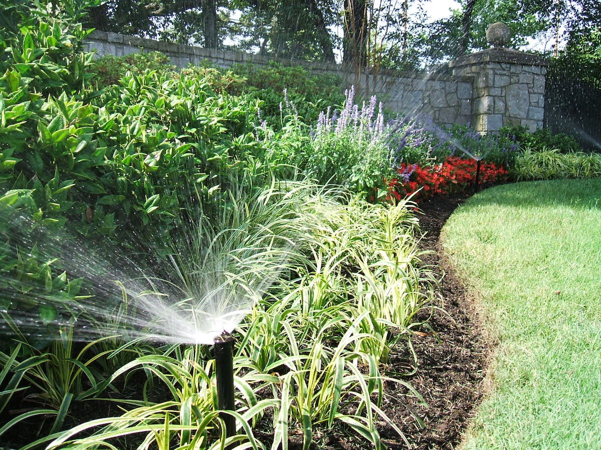 automatic irrigation waters landscape beds