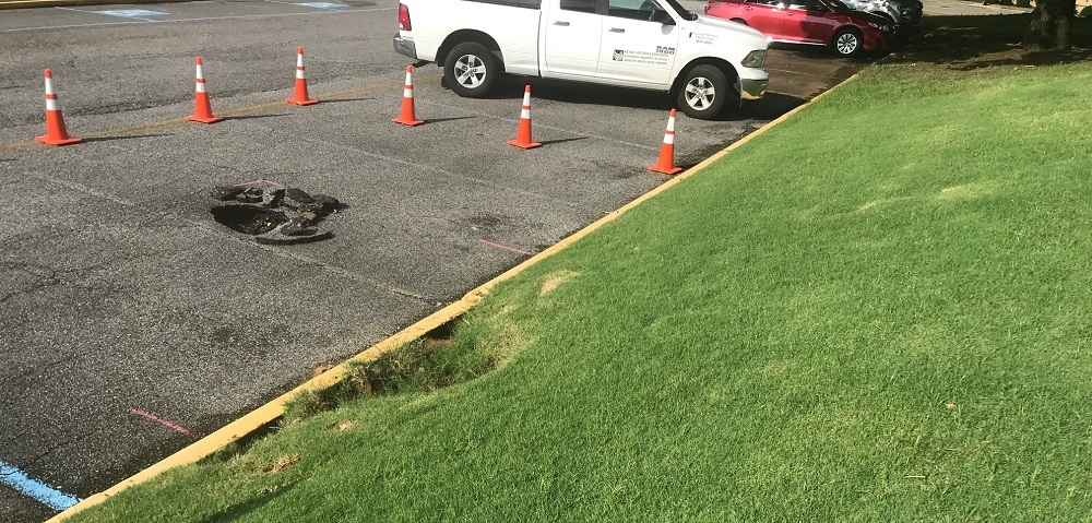 erosion damage in industrial parking lot