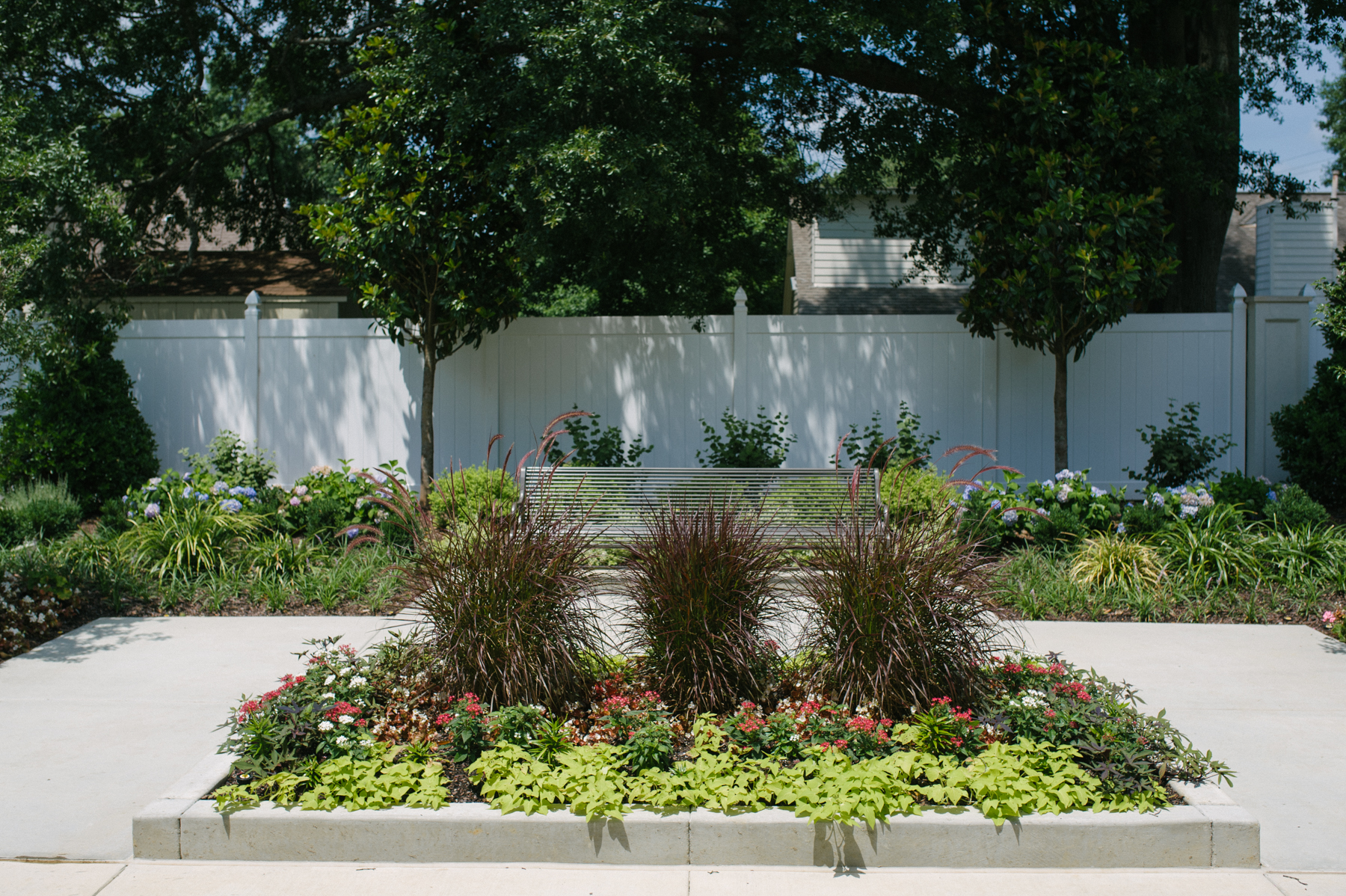 commercial-landscaping-planting-trees-shrubs-fence-bench